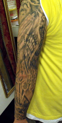 Grey Ink Angel Wings And Praying Hands Sleeve Tattoo