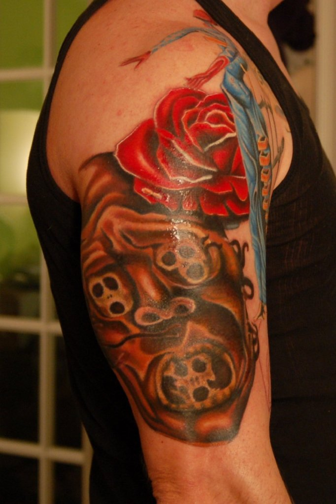Red Rose And Skulls Sleeve Tattoo