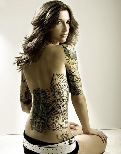 Woman With Sleeve And Back Tattoo