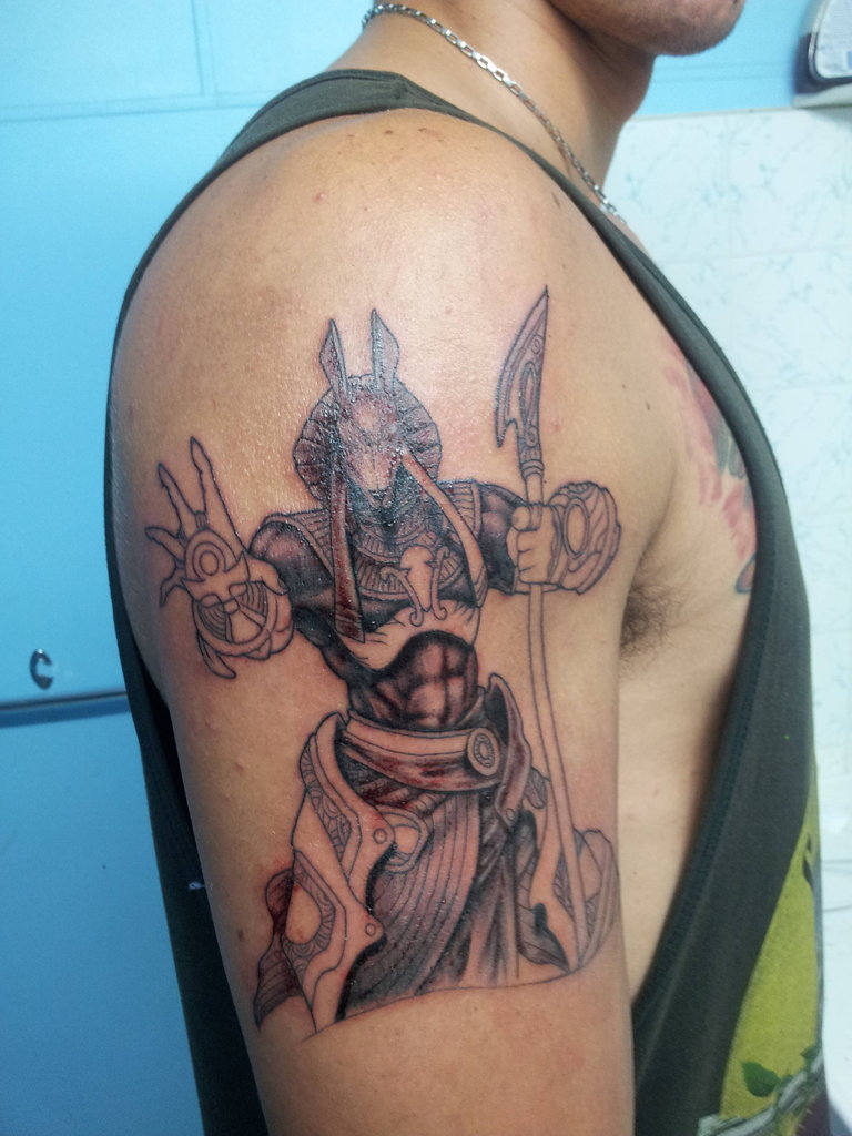 26bf56703ecf6 Grey Ink Egyptian God Tattoo On Right Half Sleeve