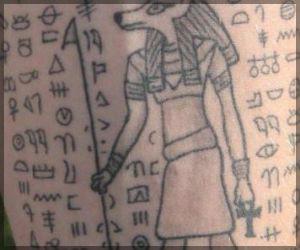 Grey Ink Egyptian Symbols And Anubis Tattoo