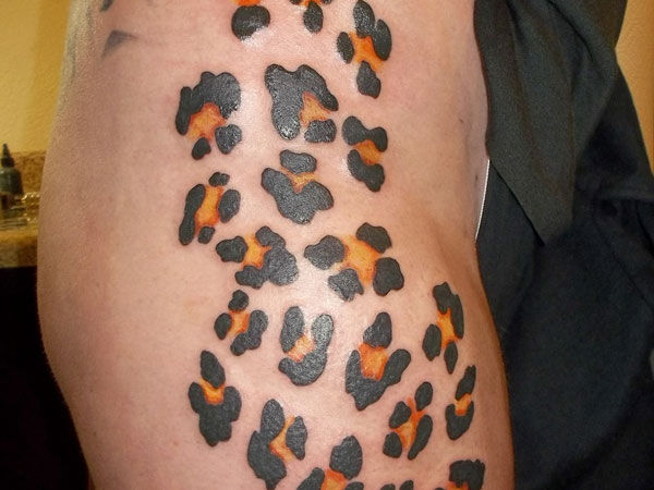 Cheetah print tattoos on thigh