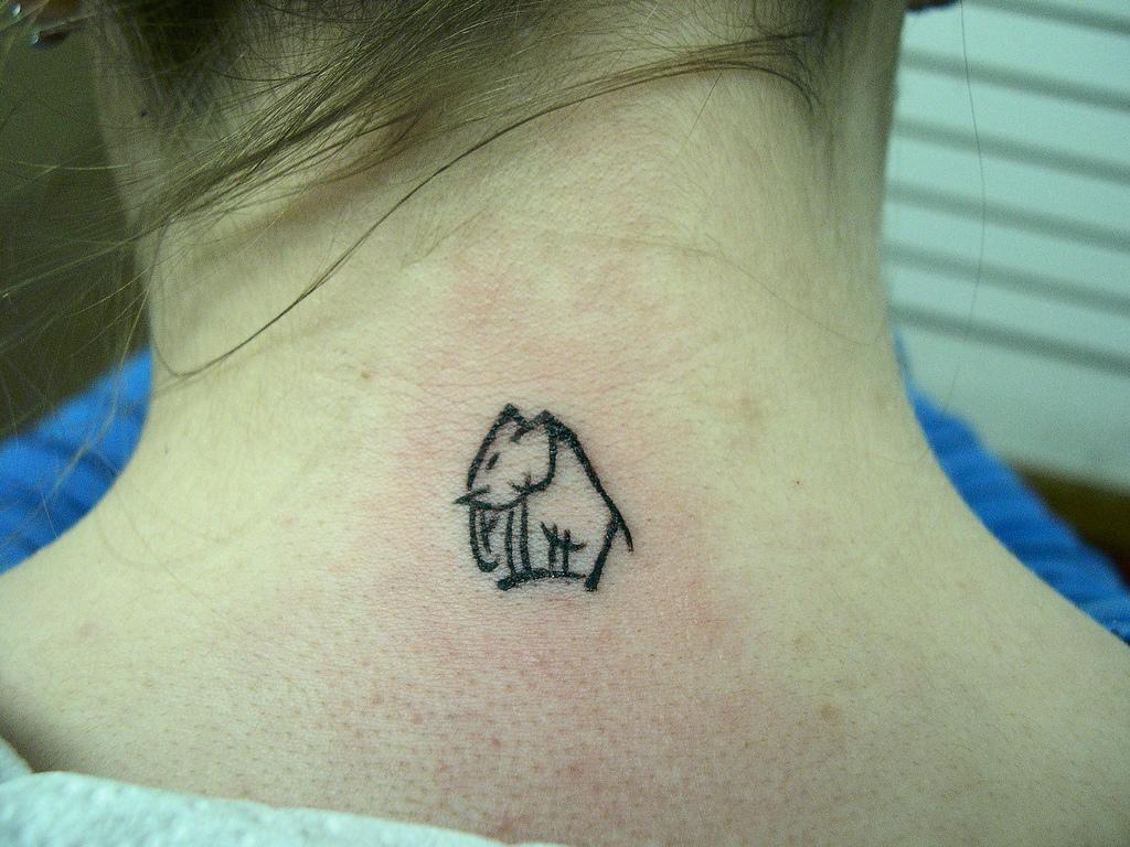 Tiny Elephant Tattoo On Finger