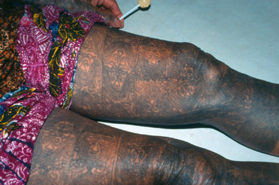 Black Ink African Thigh Tattoo
