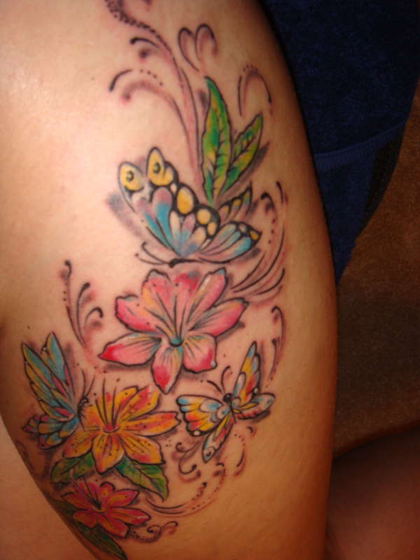 Colored flowers and butterfly thigh tattoo for Flower and butterfly tattoo
