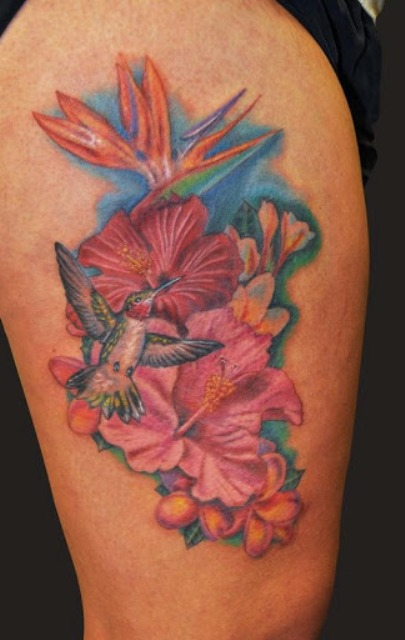 flying Hummingbird And Hibiscus Flowers Tattoo On Thigh