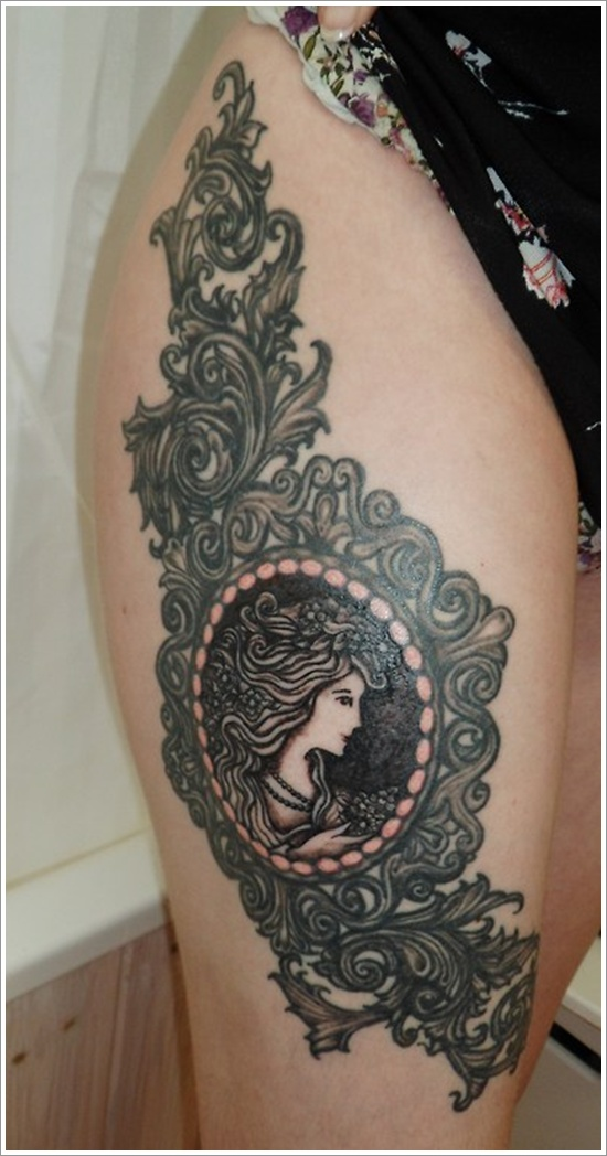 Girl Head In Frame Tattoo On Right Thigh