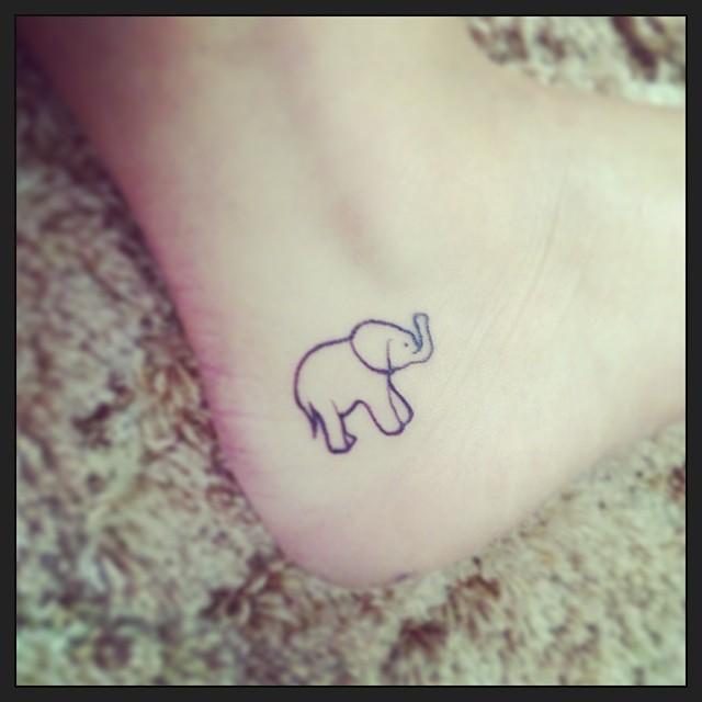outline elephant tattoo on heel