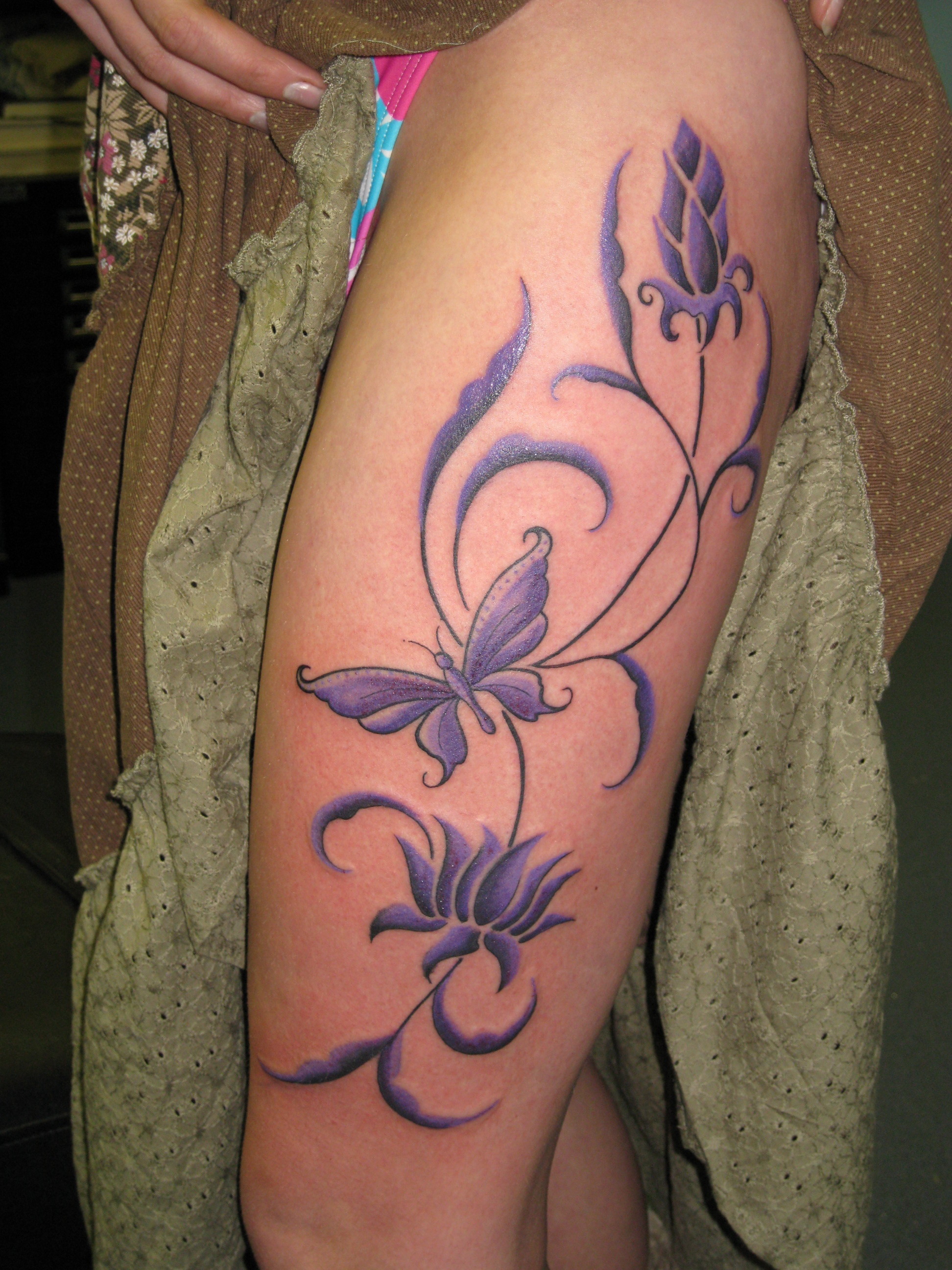 Purple flowers and butterfly thigh tattoo izmirmasajfo