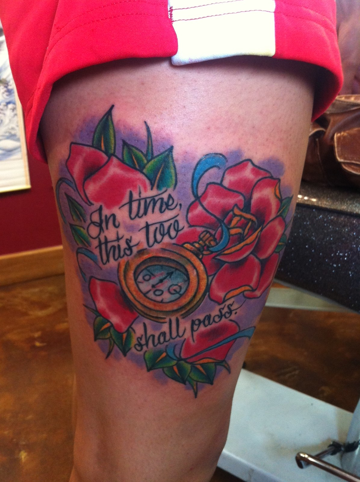 Red Flowers And Pocket Watch Thigh Tattoo