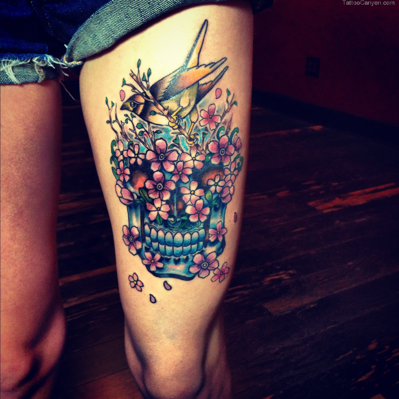 Shine Flower skull thigh tattoo this remarkable
