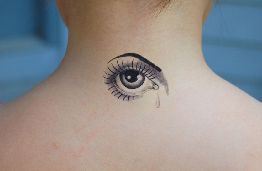 Awesome small grey ink eye tattoo on upperback for Small eye tattoo