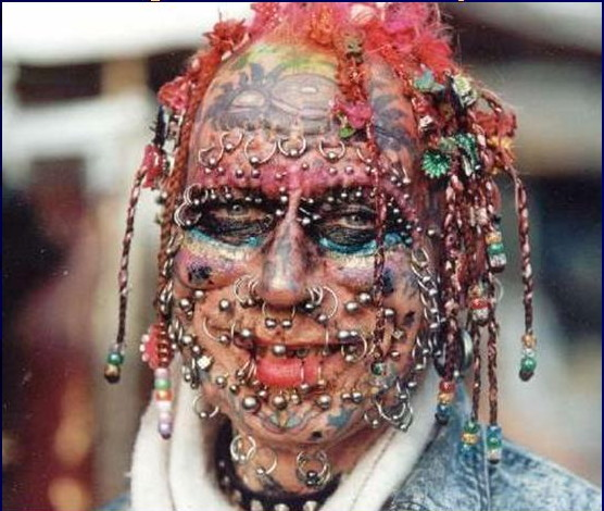 Something is. extreme tattoos and piercings right! So
