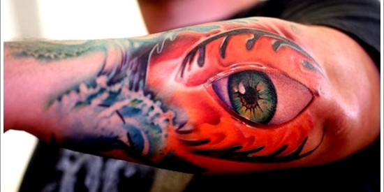 Colored Eye Tattoo On Left Arm