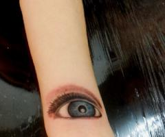 Colored Eye Tattoo On Sleeve