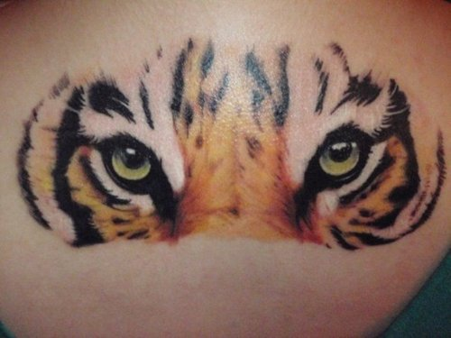 Tiger eyes tattoos lower back - photo#16