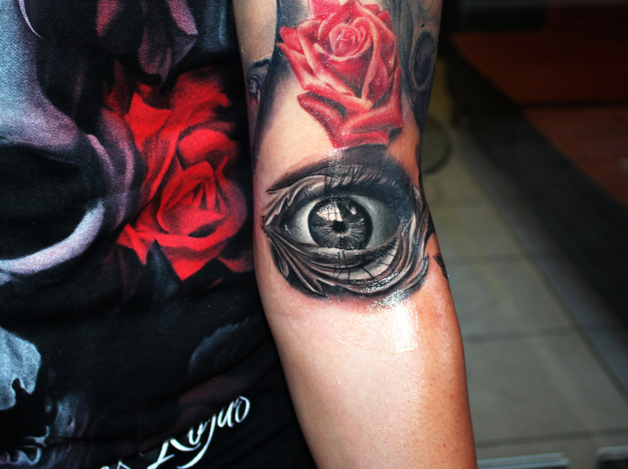 Red Rose And Eye Tattoo On Left Sleeve