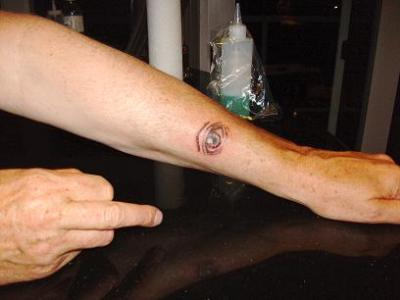 Small Eye Tattoo On Left Arm