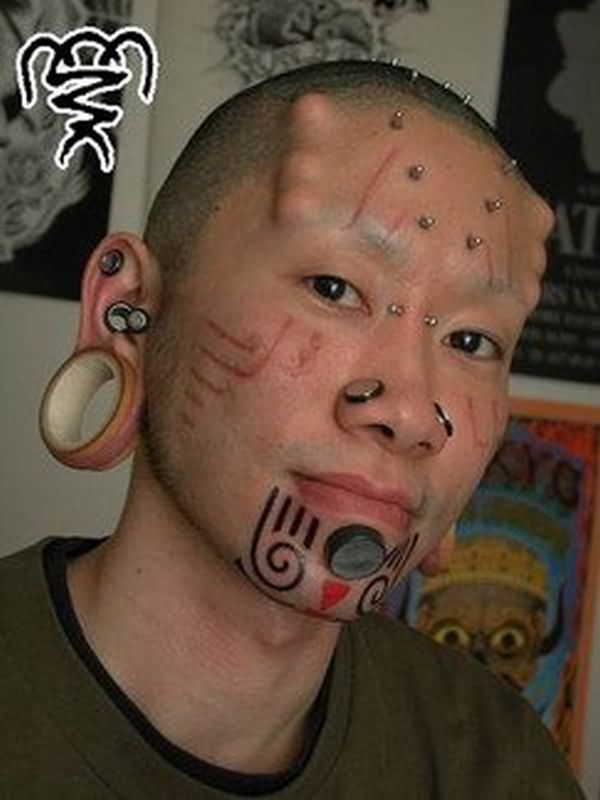 Wonderful Extreme Piercing And Tattoo On Face