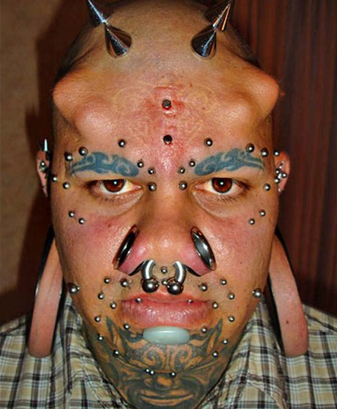 Extreme Tattoo And Piercing On Face