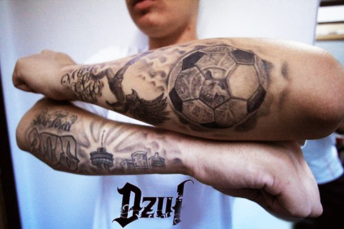 Grey Ink Football Elbow Tattoo