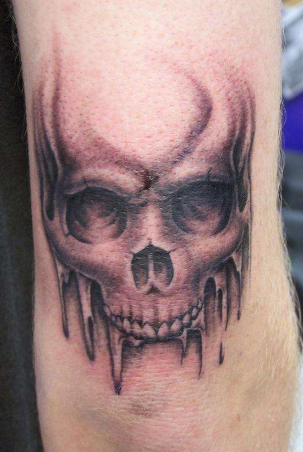 Grey Ink Skull Elbow Tattoo