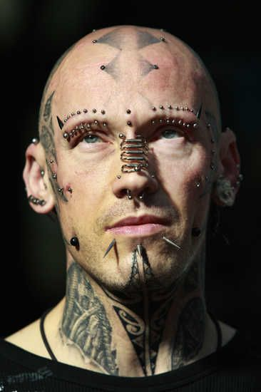 Guy With Extreme Tattoo On Face and Neck