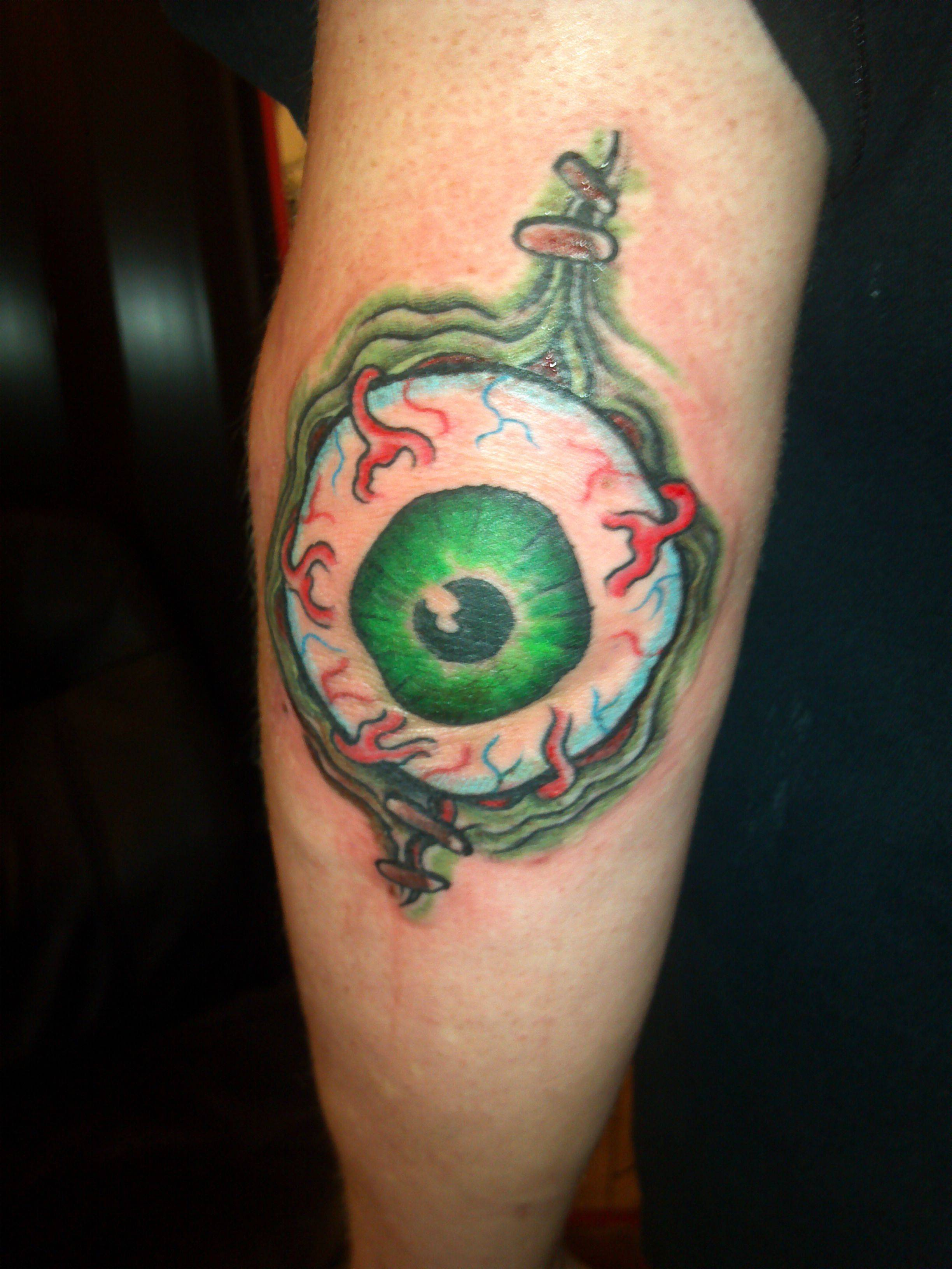 Ripped Skin Green Eyeball Elbow Tattoo