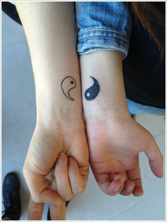 Couple With Yin Yang Tattoos On Wrists