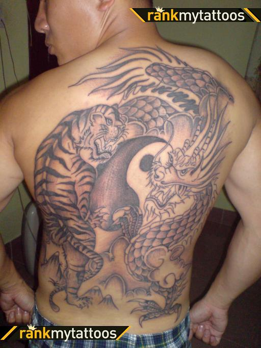 Grey Ink Dragon Yin Yang Tattoo On Back