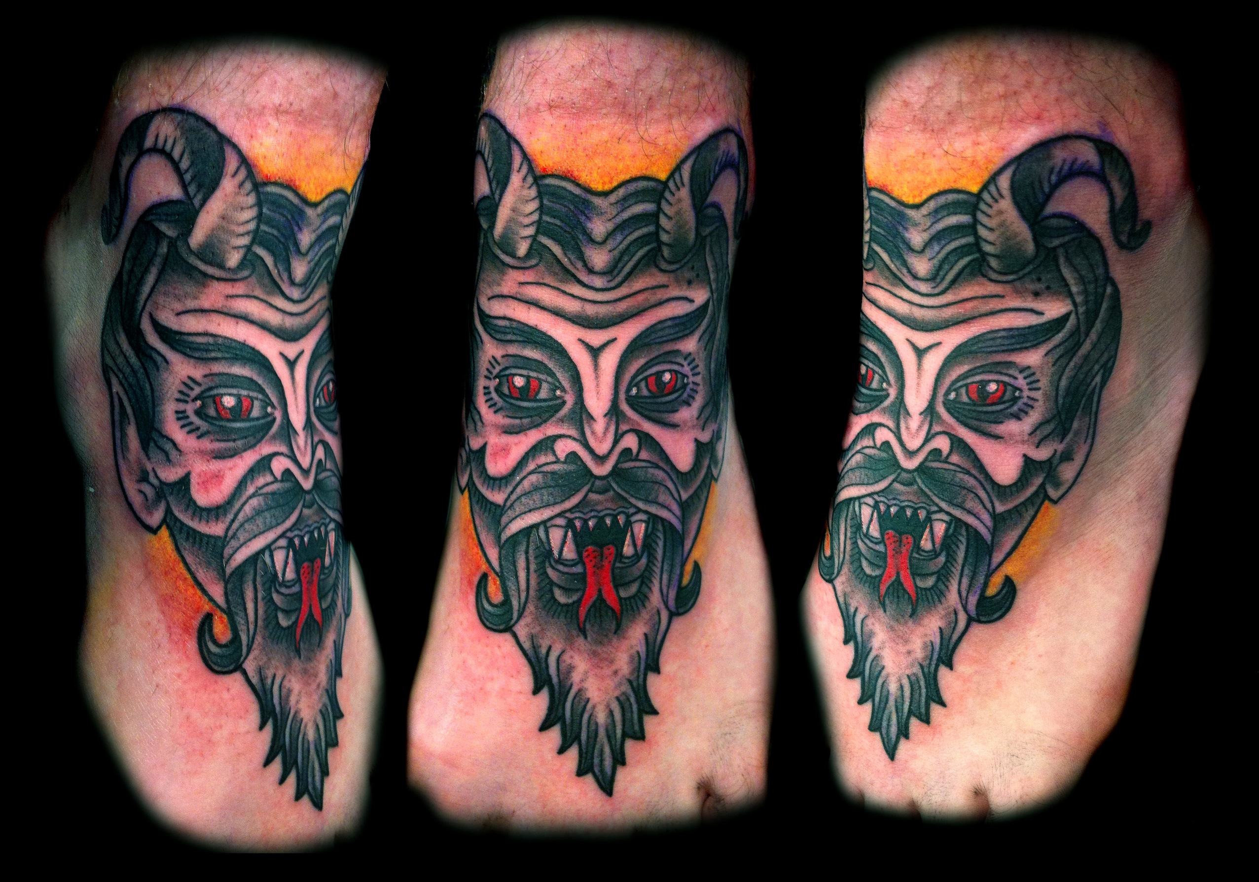 Traditional devil face mask foot tattoo design for Face mask tattoo