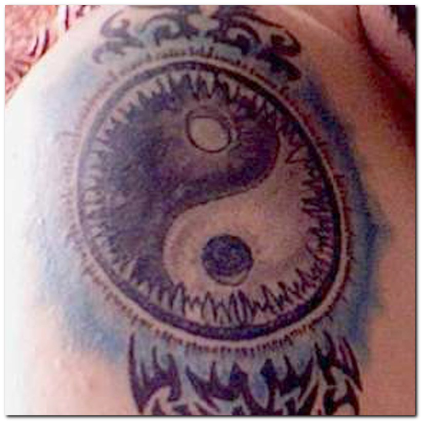 Tribal Sun And Yin Yang Tattoo On Leg