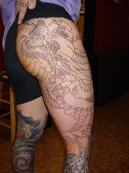 Grey ink dragon leg tattoo for Dragon tattoos on thigh