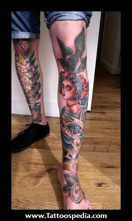 Traditional Blue Rose And Girl Head Leg Tattoo