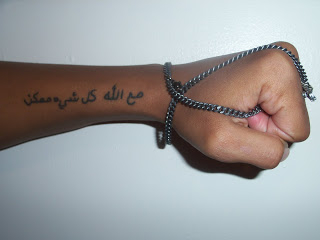 Attractive Arabic Tattoo On Left Arm