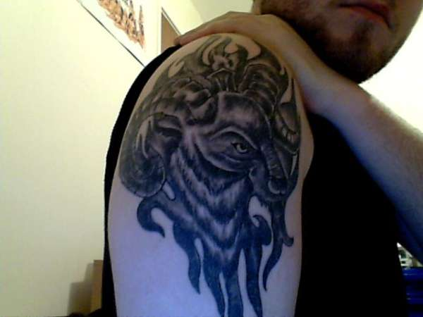 Grey Ink Aries Tattoo On Man Right SHoulder