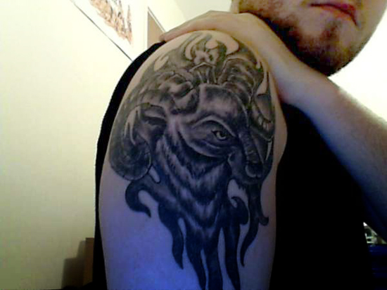 Grey Ink Goat Head Aries Tattoo On Man Right Shoulder