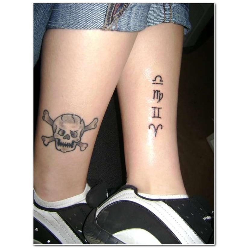 Grey Ink Pirate Skull And Zodiac Libra, Gemini And Aries Sign Tattoo On Leg