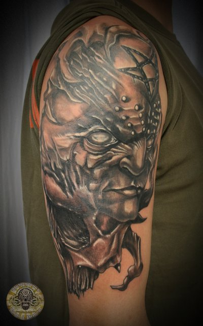 Face tattoo images designs for Demon half sleeve tattoos