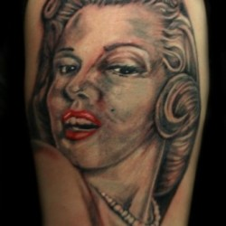 Latest Black Ink Tribal Face TattooMarilyn Monroe Face Tattoo On Shoulder