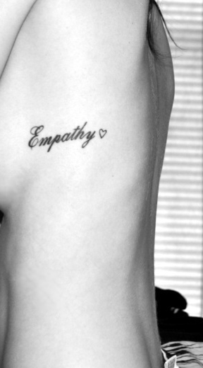 Empathy Feminine Tattoo On Girl Side Rib