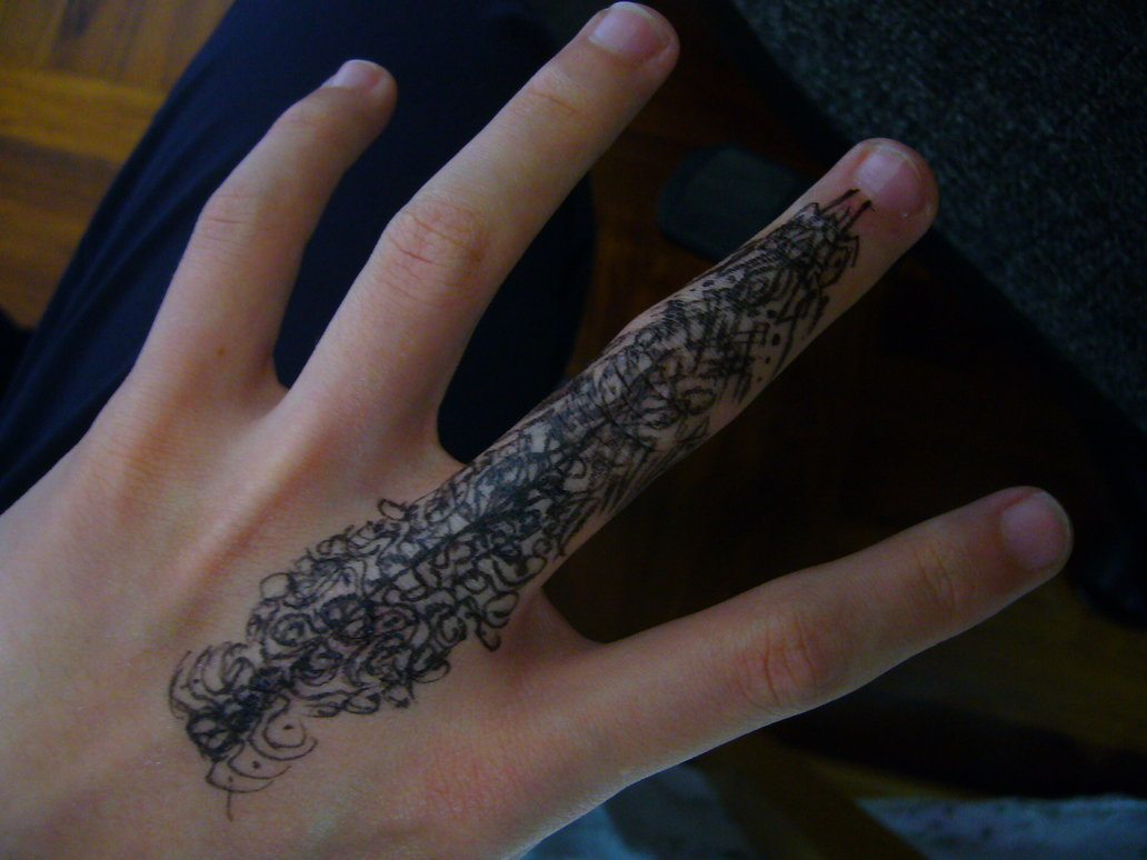 Amazing black ink finger tattoo for Black tattoo ink