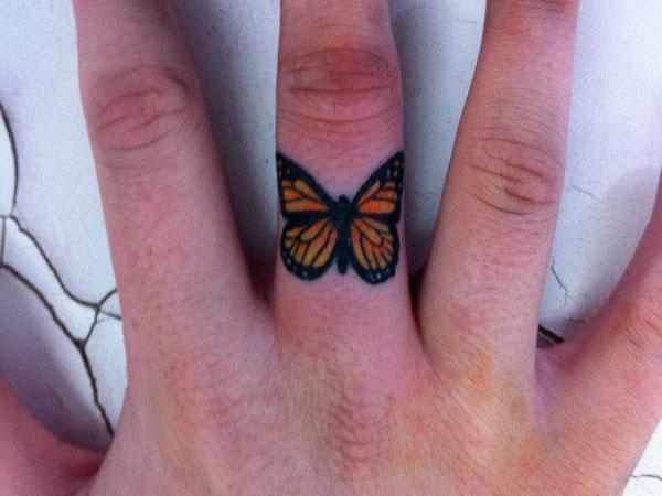 Butterfly tattoo on finger
