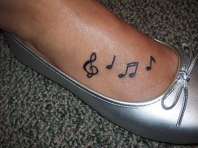 Feminine tattoo images designs for Feminine music tattoos
