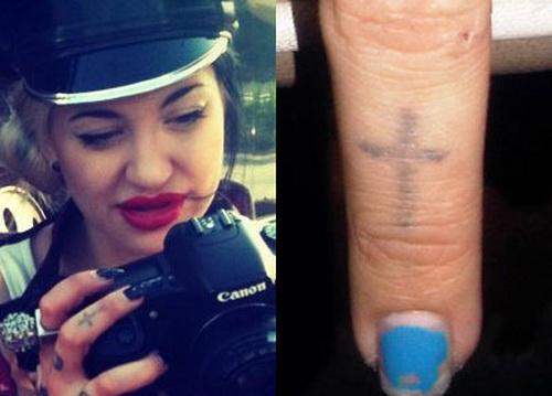 Small Cross Tattoo On Finger