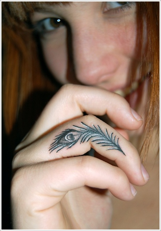 Small Peacock Feather Tattoo On Finger