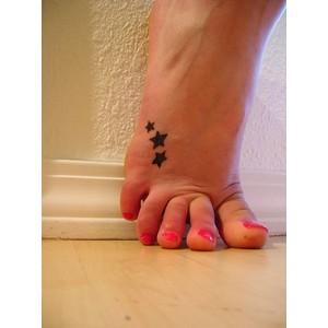 Feminine tattoo images designs for Star tattoos on foot