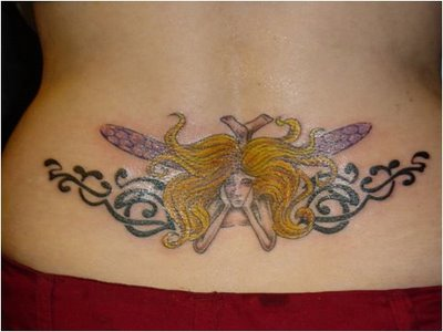 tribal and tinkerbell feminine tattoo on lowerback. Black Bedroom Furniture Sets. Home Design Ideas