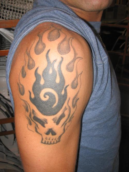 Grey Ink Skull With Fire And Flames Tattoo On Shoulder