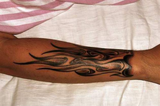 tribal arm tattoo Flames Arm On Tribal Tattoo